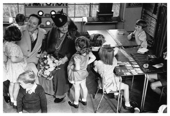 Maria Montessori with a class